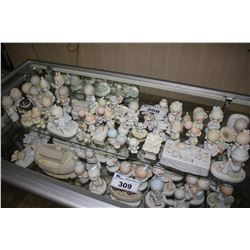 LARGE SHELF LOT OF ASSORTED ENESCO PRECIOUS MOMENTS COLLECTABLE FIGURINES