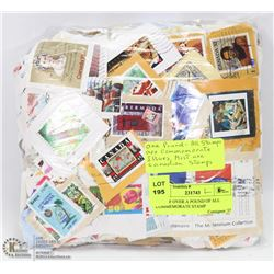 BAG OF OVER A POUND OF ALL COMMEMORATE STAMP