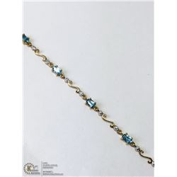 21) 10KT GOLD BLUE TOPAZ DIAMOND BRACELET