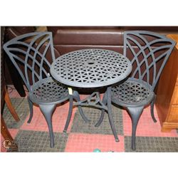 TABLE WITH TWO CAST IRON CHAIRS.