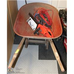 RED WHEELBARROW WITH EXTENSION CORDS AND HEDGE