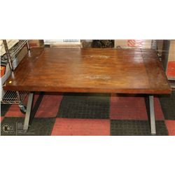 WOOD TONE AND METAL COFFEE TABLE DAMAGED AS IS
