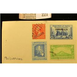 Four Philippines Islands very old Stamps on a card. One or two are uncancelled.