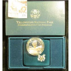 1999 Yellowstone National Park Silver Proof Dollar in original box as issued. CDN bid is $32.00.