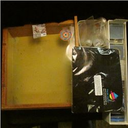 """Group of Plastic Coin Cases, a few tubes, and a """"Jackmaster Pocket Knives"""" Wooden display case."""