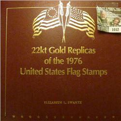 1012 _ 50 Piece Set of 22kt Gold Replicas of the United States Flag Stamps in a speical album. Each