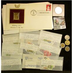 1022 _ Collection of Stamps and a few coins and tokens.  The Stamps include a 22K Gold Replica Stamp