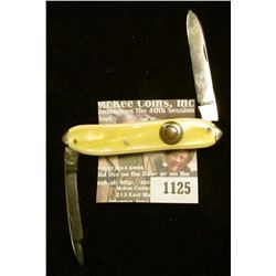 "1125 _ Western Two-blade Folder Knife with 2 1/4"" blades, yellow mother-of-pearl handle, brass inlay"