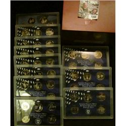 1168 _ Complete 1999-2009 S Proof State Quarter Sets in original plastic cases and a Cherry Wood Box