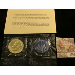 1490 _ 1973 S Silver Eisenhower Dollar in original blue pack as issued. Includes C.O.A.