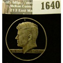 1640 _ Cut-Out Kennedy Half Dollar. ND. (1964-1970)