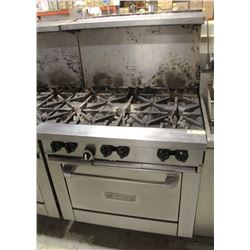 6 BURNER GARLAND STOVE WITH SHELF AND 8 WHEELS