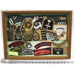 COLLECTION OF VINTAGE MILITARY PATCHES IN GLASS