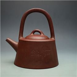"Late Qing Dynasty, ""Pengnian"" Mark on the bottom;A Fine Loop-Handled Yixing Teapot with Side Mark of"