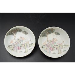 """Early 20th Century, a pair of famille-rose """"figures"""" dishes, """"Jiangxi Xiang Yi Long"""""""