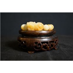 A Jadeite Bead Bracelet(Shou chuan) with one of the beads cut in a Pixiu Shape
