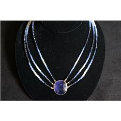 A Sapphire Necklace mounted in 14K Gold with Certification. Small Crack on Sapphire. Estimate Price: