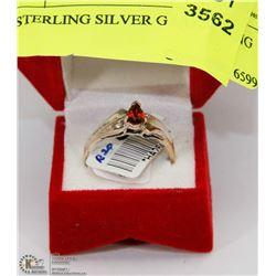 79) STERLING SILVER GARNET RING