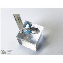 34) 14KT WHITE GOLD BLUE TOPAZ & CUBIC RING