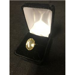 HUGE SOLID GOLD .375 RING WITH LIGHT YELLOW STONE APPROX 14 CARATS