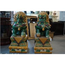 "A Pair of Two Xiang Rui ""San Cai"" Ceramic Lions. Condition as is, shown in photos."