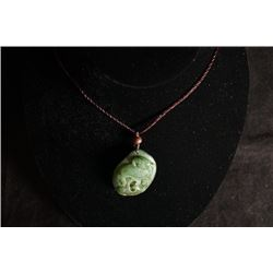 A jade pendant. Condition as is, shown in photo