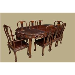 A Large Rosewood Table with the Edge Carved in Floral Shape & Eight Rosewood Chairs, the length of t