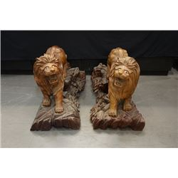 A pair of Early 20th Century Wood Carved lions. Condition as is, shown in photos.