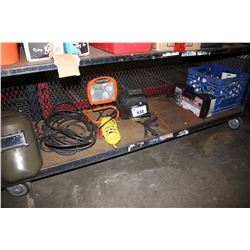 SHELF LOT INCLUDING WELDING HELMETS, SHOP LIGHT, CABLE LINK TIRE CHAINS AND MORE