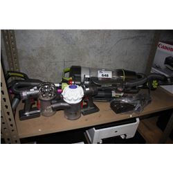 SHELF OF DYSON AND HOOVER VACUUMS