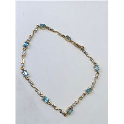 10KT. GOLD BLUE TOPAZ (2.21CT) DIAMOND (0.04CT) BRACELET