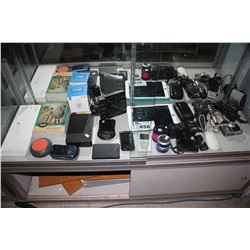 SHELF OF ELECTRONICS INCLUDING IPAD, SMART WIFI PLUG, MINI SCALE, CELL PHONES AND MORE
