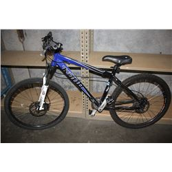 BLUE/BLACK KONA BLAST 24-SPEED MOUNTAIN BIKE WITH DISC BRAKES AND ROCKSHOX