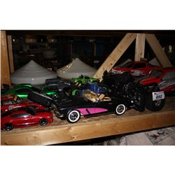 SHELF LOT OF REMOTE CONTROL CARS