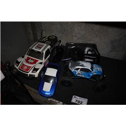 SHELF LOT OF RC CARS