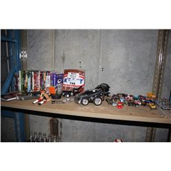 SHELF LOT INCLUDING TOY CARS, DVDS, AND MORE