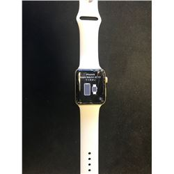 42MM APPLE WATCH WITH CHARGER (POWERS UP. CRACKED SCREEN, WORKING CONDITION UNKNOWN)