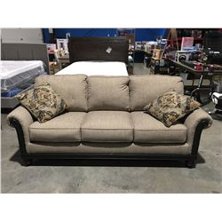 CONTEMPORARY LIGHT BEIGE UPHOLSTERED WOOD TRIMMED 3 SEATER SOFA WITH 2 THROW CUSHIONS