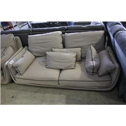 BEIGE FABRIC COUCH WITH GREEN TRIM