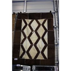 WOVEN COWHIDE AREA RUG