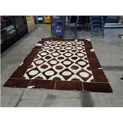 LARGE WOVEN COWHIDE AREA RUG