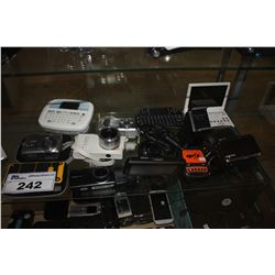 LOT OF ELECTRONICS INCLUDING CAMERAS, GPS SYSTEMS AND MORE