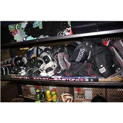 LARGE SHELF LOT OF ASSORTED HOCKEY EQUIPMENT INCLUDING SKATES, ROLLER BLADES, PADDING, HOCKEY