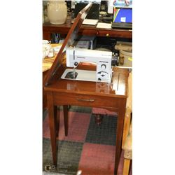 VINTAGE DOMESTIC SEWING MACHINE IN CABINET