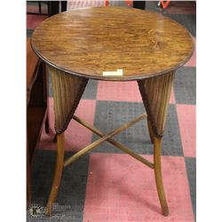 WOOD ROUND OCCASIONAL TABLE WITH WICKER ACCENTS
