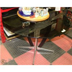 """TABLE WITH SMOKED GLASS TOP 42"""" DIAMETER 29""""H."""