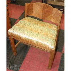 ANTIQUE WOOD CARVED CHAIR W/ SILK PRINTED CUSHION.