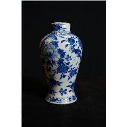 "Qing Dynasty, a small blue-and-white ""flowers"" vase"