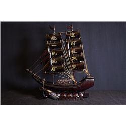 """""""Yuan Qian Cheng Wan Li, Zhu Yi Fan Feng Shun"""", a wodden ship display."""