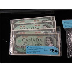 Four 1967 Canadian One Dollar Bills - Near Mint